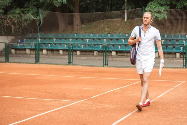 athletic tennis player after training on tennis court  - Photo, Image