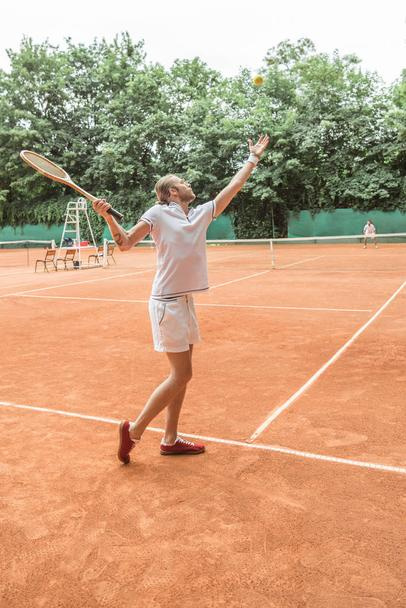 athletic men playing tennis with retro wooden rackets on court - Photo, Image