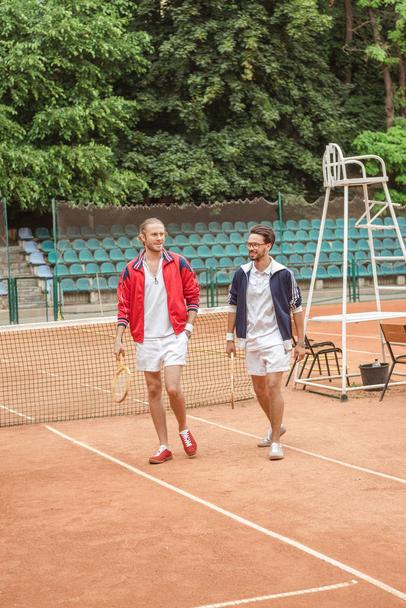 old-fashionedfriends with wooden rackets walking on tennis court - Photo, Image