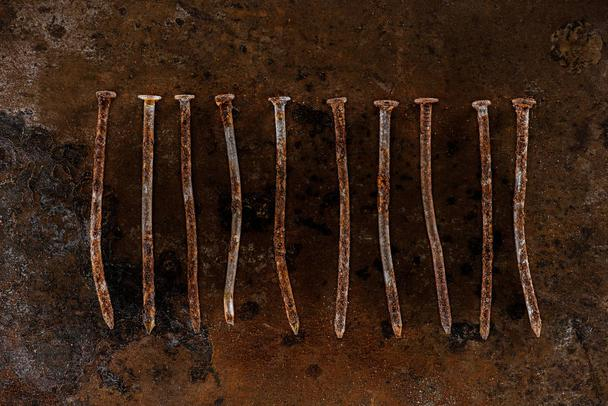 flat lay with vintage nails arranged on sharped rusty surface - Photo, Image