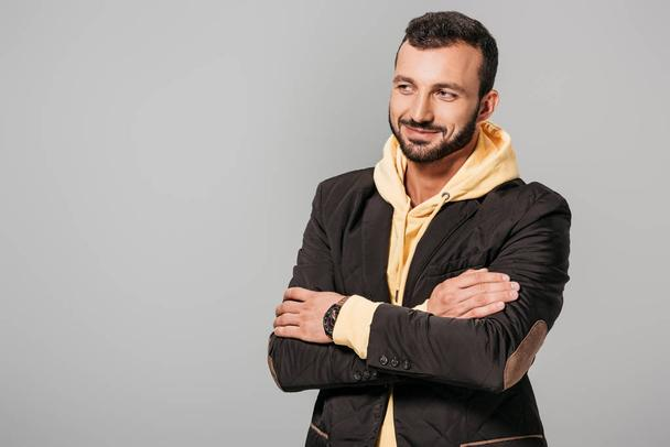 smiling male model posing with crossed arms isolated on grey background  - Photo, Image
