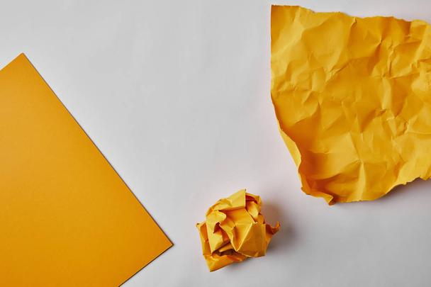 top view of yellow papers on white surface - Photo, Image