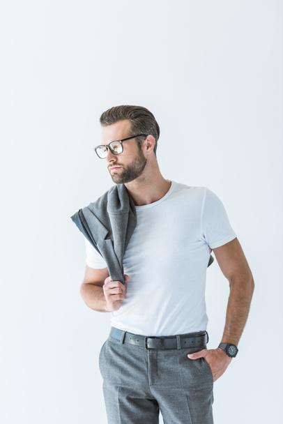 stylish confident man with gray jacket on shoulder, isolated on white - Photo, Image