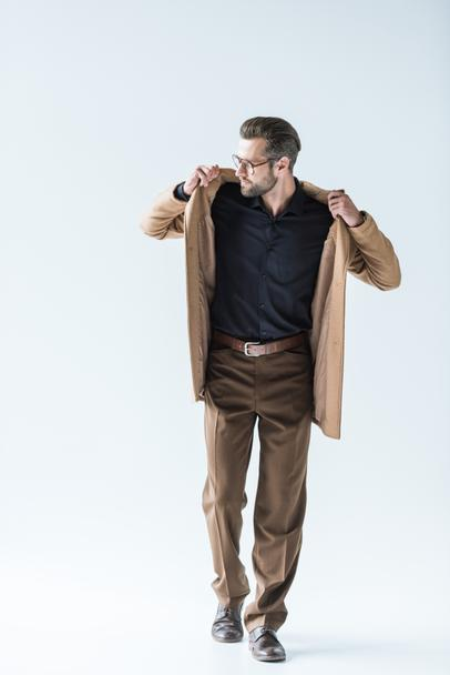 handsome bearded man posing in stylish autumn outfit, isolated on white - Photo, Image