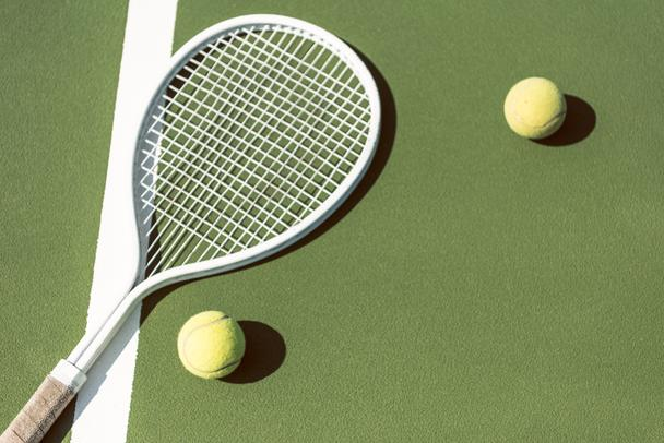 close up view of tennis equipment on green tennis court - Photo, Image