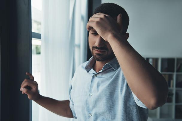 upset man suffering from headache at home - Photo, Image