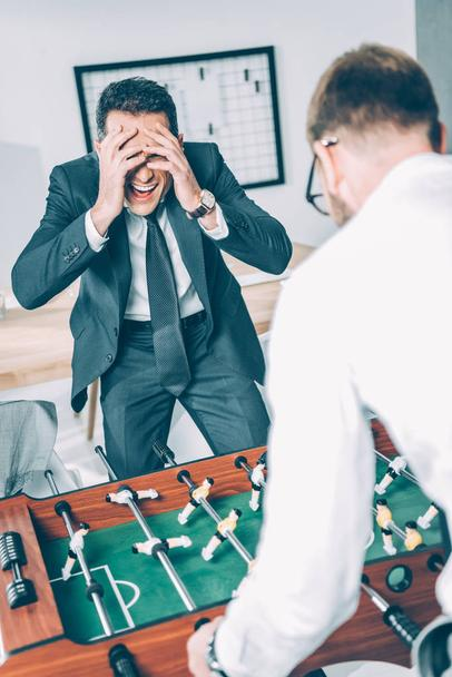 businessmen playing table football in modern office  - Photo, Image