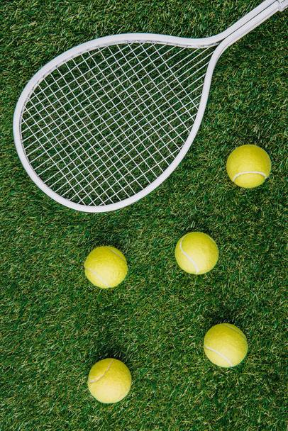 top view of tennis equipment of green grass - Photo, Image