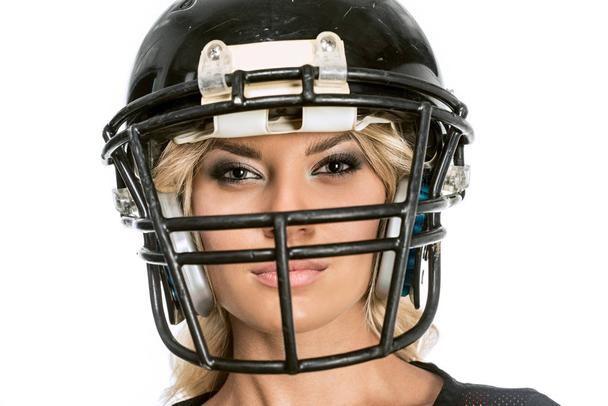 close-up shot of serious young woman in american football helmet looking at camera isolated on white - Photo, Image