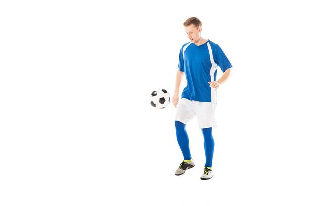 full length view of handsome young soccer player training with ball isolated on white  - Photo, Image