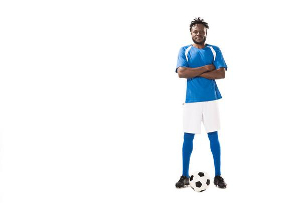 confident african american soccer player standing with crossed arms and looking at camera isolated on white  - Photo, Image