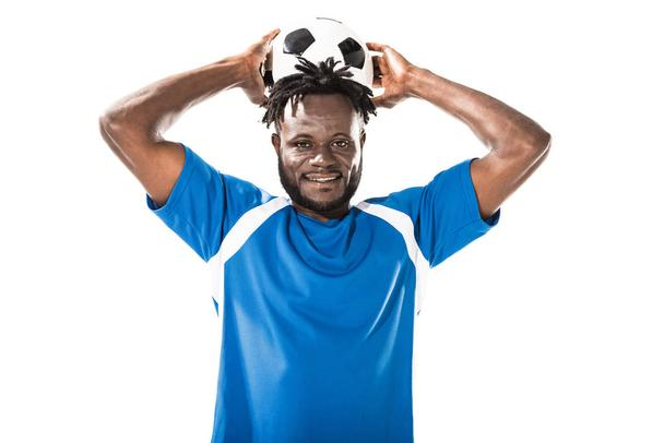 african american sportsman holding soccer ball above head and smiling at camera isolated on white - Photo, Image