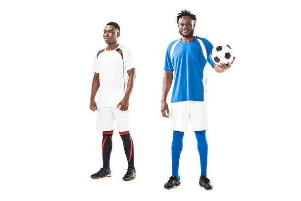 full length view of athletic young african american sportsmen standing with soccer ball isolated on white  - Photo, Image