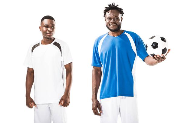 handsome smiling young african american soccer players standing with ball isolated on white - Photo, Image