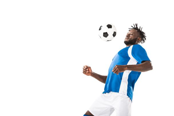 athletic young african american soccer player hitting ball with chest isolated on white   - Photo, Image
