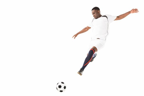 young african american soccer player kicking ball in jump isolated on white  - Photo, Image