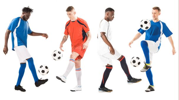 full length view of young multiethnic soccer players training with balls isolated on white - Photo, Image
