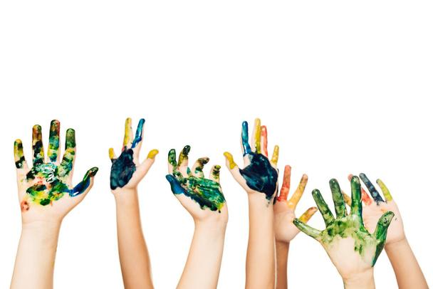 cropped shot of children showing hands in colorful paint isolated on white - Photo, Image
