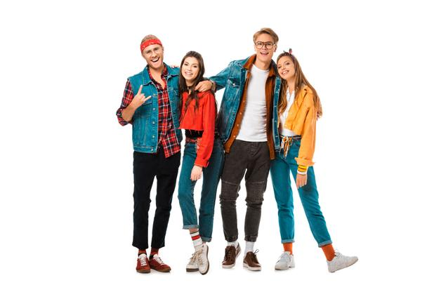 male hipster man in denim vest showing rock gesture while his friends standing near isolated on white - Photo, Image