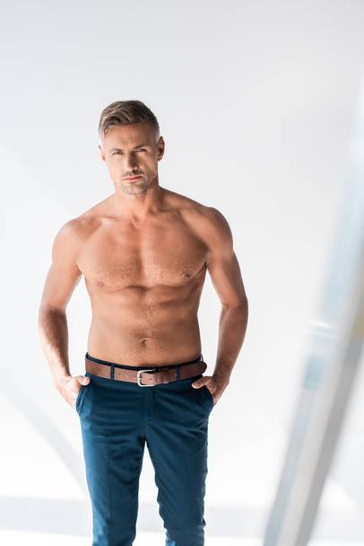 serious shirtless adult man looking at camera on white - Photo, Image