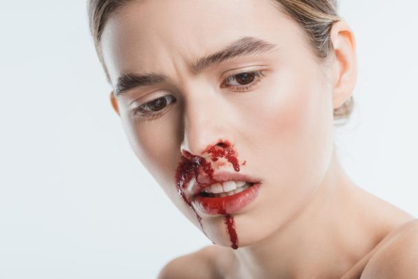 close up of sad wounded woman with blood in face after domestic violence isolated on white - Photo, Image