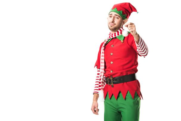man in christmas elf costume holding bauble and looking at camera isolated on white background - Photo, Image