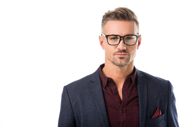 portrait of stylish man in eyeglasses and jacket looking at camera isolated on white - Photo, Image