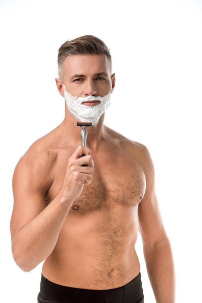 adult man with foam on face shaving with razor isolated on white - Photo, Image