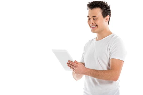 smiling handsome man using digital tablet isolated on white - Photo, Image