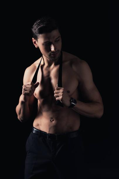 handsome shirtless man posing isolated on black - Photo, Image