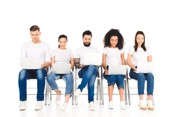multicultural cheerful group of young people using laptops isolated on white - Photo, Image