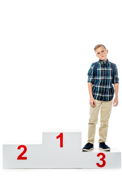 disappointed boy standing on winner podium and looking at camera isolated on white - Photo, Image