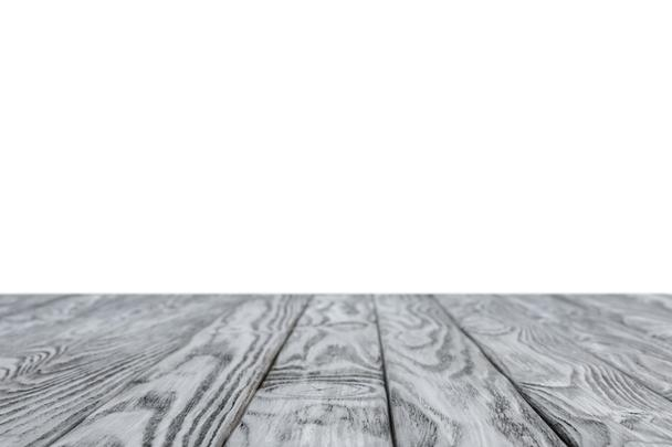 selective focus of grey striped wooden background on white - Photo, Image