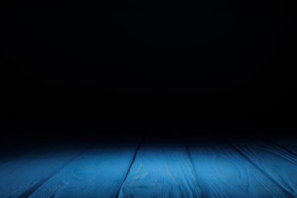 blue striped wooden tabletop on black - Photo, Image