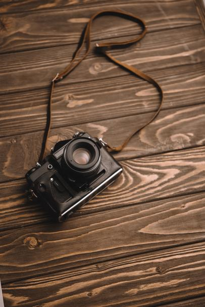 retro photo camera on wooden table with copy space - Photo, Image