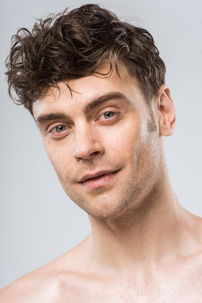 portrait of brunette young sexy man isolated on grey - Photo, Image