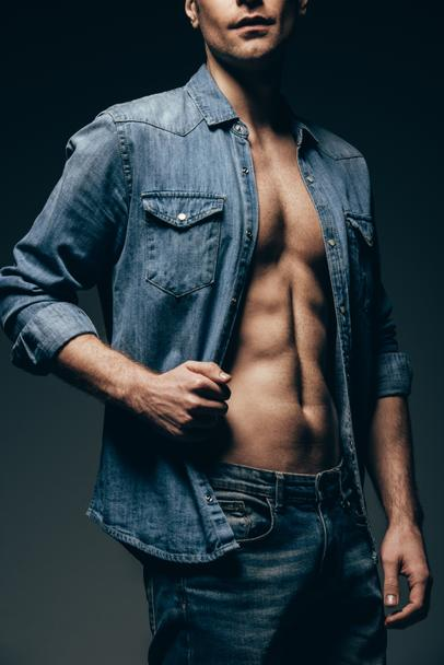 cropped view of sexy man posing in denim shirt isolated on grey - Photo, Image