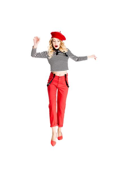 surprised woman in red beret looking at floor isolated on white - Photo, Image