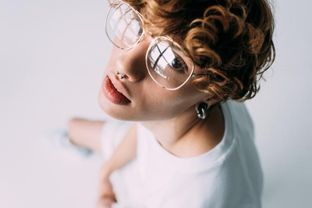 handsome man with curly hair in glasses isolated on grey - Photo, Image
