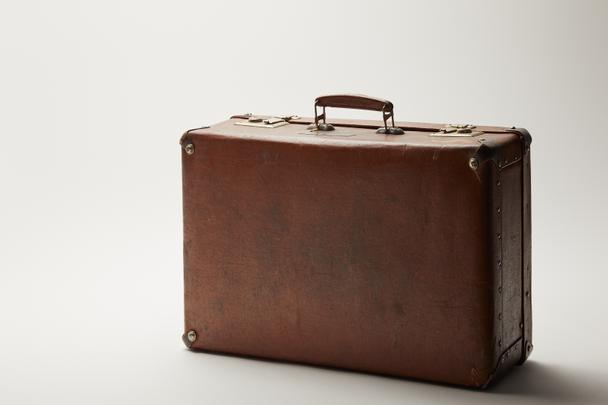 retro leather brown suitcase on grey background  - Photo, Image