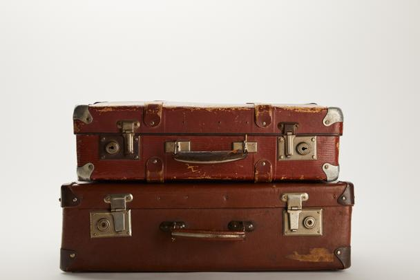 vintage brown suitcases on grey background with copy space  - Photo, Image