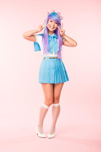 Full length view of cheerful asian otaku girl showing peace signs on pink - Photo, Image