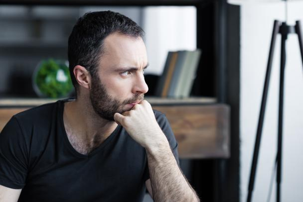 thoughtful handsome man holding hand near face and looking away - Photo, Image