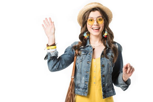 front view of excited boho girl in boater waving hand isolated on white - Photo, Image
