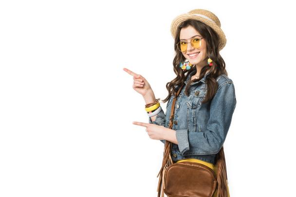 smiling boho girl in boater pointing with fingers isolated on white - Photo, Image