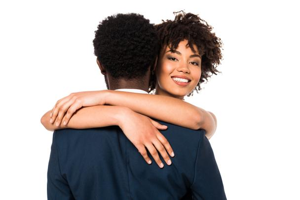 attractive and smiling african american woman hugging man isolated on white  - Photo, Image