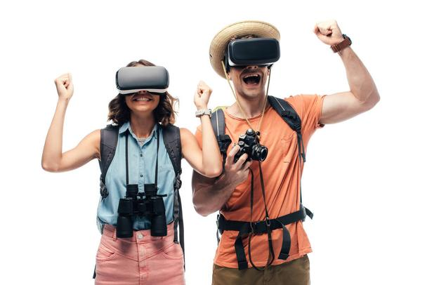 two cheerful tourists showing yes gestures while using virtual reality headsets isolated on white - Photo, Image