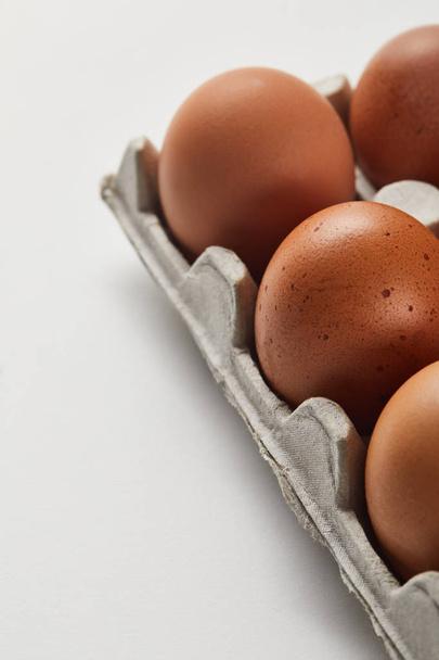 selective focus of chicken eggs in carton box - Photo, Image