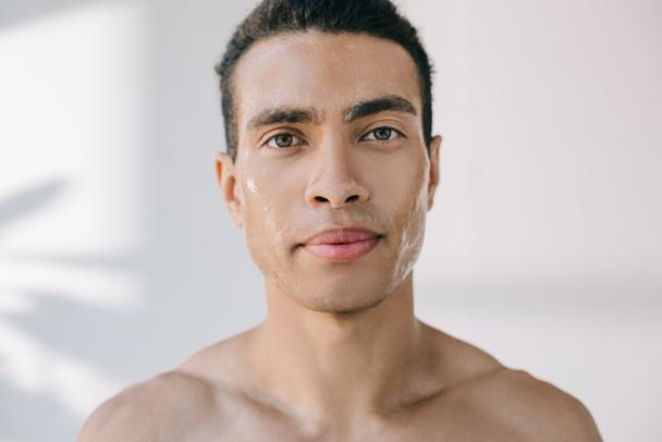 handsome serious young man with wet face looking at camera - Photo, Image