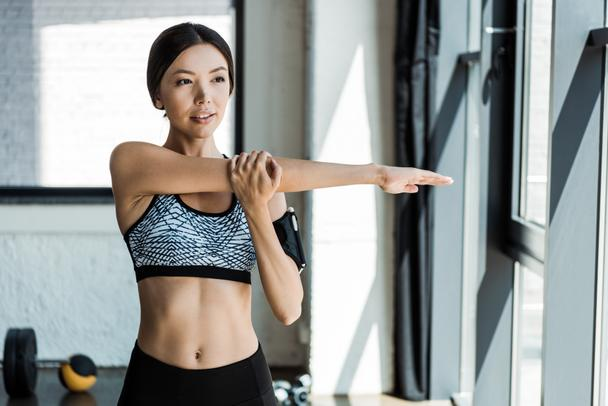 beautiful and young athletic woman working out in sports center - Photo, Image
